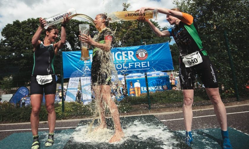 The Scottish Middle Distance Champion Alison Rowatt getting drenched after the prize giving!